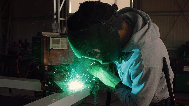 a worker handling steel